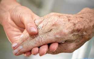 holding hands - palliative care