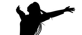 Silhouette of a woman with her arms outstretched