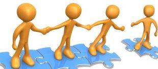 Stick humanoid figures holding hands, standing on interlocking jigsaw pieces