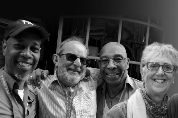 Older LGBT men and women smiling