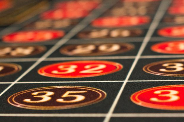 A close up of numbered squares on a casino blackjack table