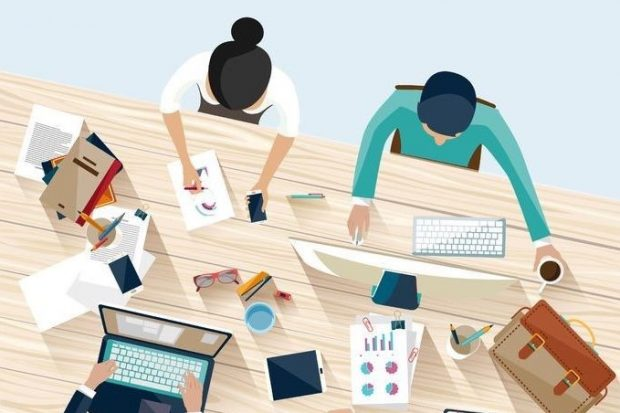 Overhead illustration of people working together on a shared office desk.