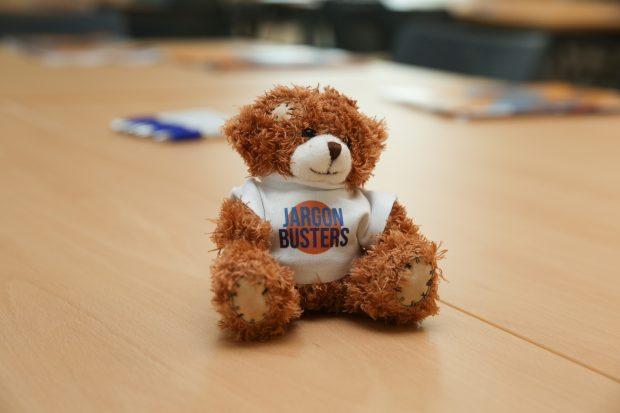 A teddy bear wearing a jargon buster t-shirt