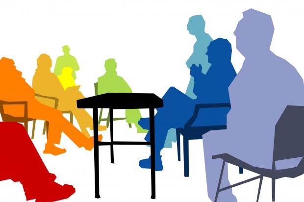 Multicoloured silhouettes of conference attendees