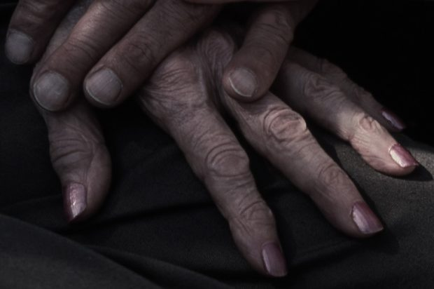 Wrinkled hands of an older person