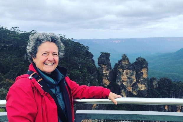 Lyn Romeo enjoys a mountain view on a yoga retreat in Australia.