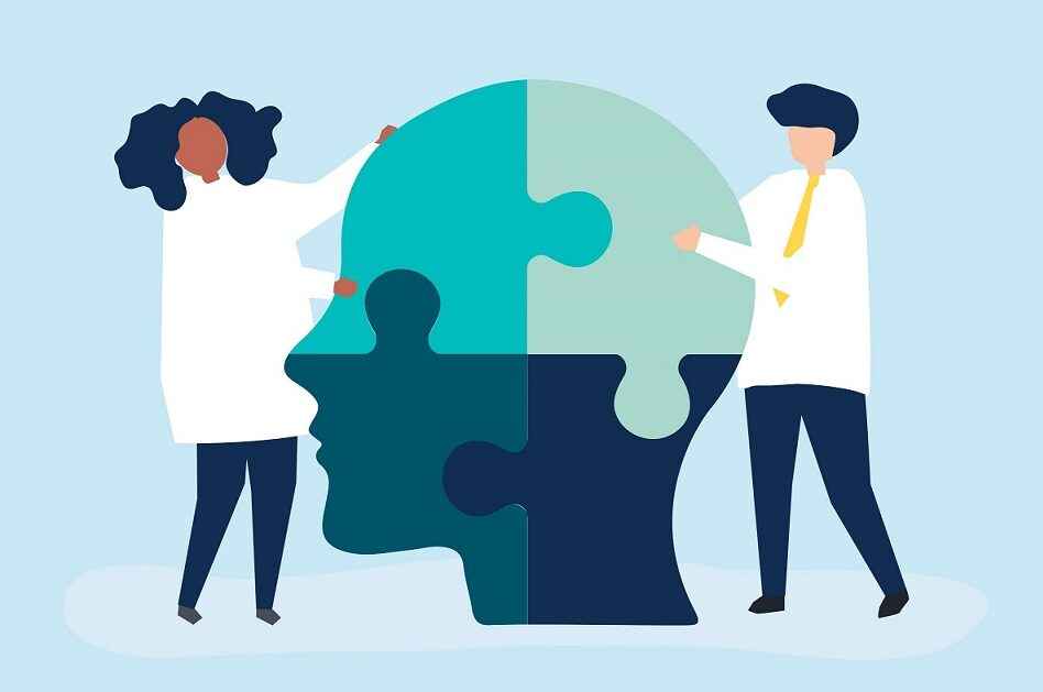 Two people slotting together jigsaw pieces of the mind